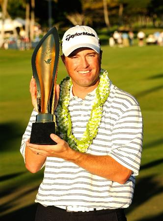 HONOLULU - JANUARY 17:  Ryan Palmer poses with the trophy after winning the Sony Open at Waialae Country Club on January 17, 2010 in Honolulu, Hawaii.  (Photo by Sam Greenwood/Getty Images)