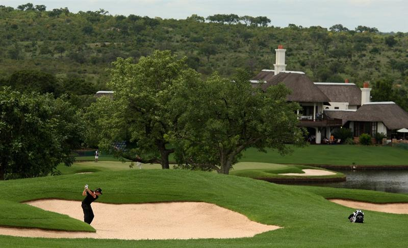 MALELANE, SOUTH AFRICA - DECEMBER 11:  Michael Lorenzo-Vera of France plays out of the 18th fairway bunker during the third round of the Alfred Dunhill Championship at Leopard Creek Country Club on December 12, 2008 in Malelane, South Africa.  (Photo by Warren Little/Getty Images)