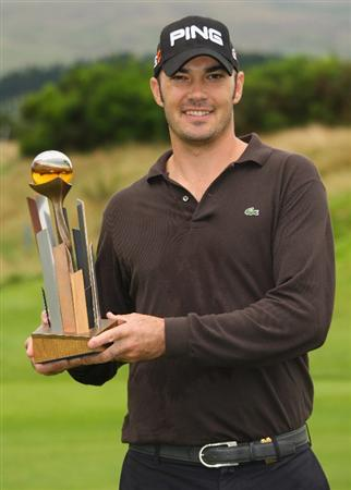 PERTH, UNITED KINGDOM - AUGUST 31:  Gregory Havret of France poses with the trophy after winning The Johnnie Walker Championship at Gleneagles on August 31, 2008 at the Gleneagles Hotel and Resort in Perthshire, Scotland.  (Photo by Andrew Redington/Getty Images)