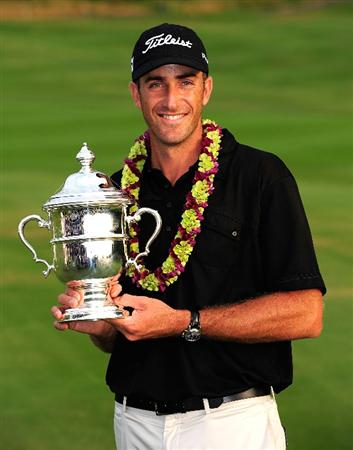 KAPALUA, HI - JANUARY 10:  Geoff Ogilvy of Australia poses with the trophy after winning the SBS Championship at the Plantation course on January 10, 2010 in Kapalua, Maui, Hawaii.  (Photo by Sam Greenwood/Getty Images)