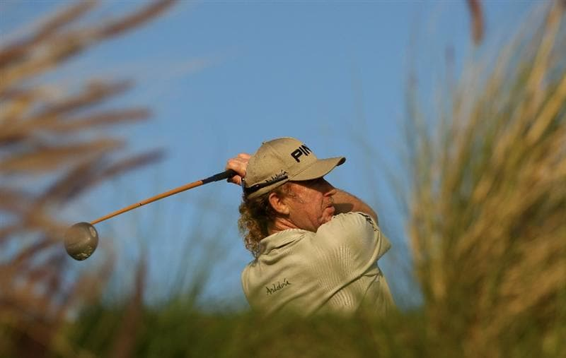 DOHA, QATAR - FEBRUARY 03: Miguel Angel Jimenez of Spain on the 16th tee during the first round of the Commercialbank Qatar Masters at the Doha Golf Club on February 3, 2011 in Doha, Qatar.  (Photo by Ross Kinnaird/Getty Images)