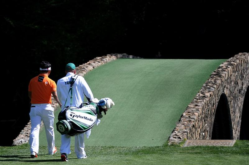 AUGUSTA, GA - APRIL 07:  Y.E. Yang of South Korea walks to the Hogan Bridge with his caddie Michael Bestor during the first round of the 2011 Masters Tournament at Augusta National Golf Club on April 7, 2011 in Augusta, Georgia.  (Photo by Harry How/Getty Images)