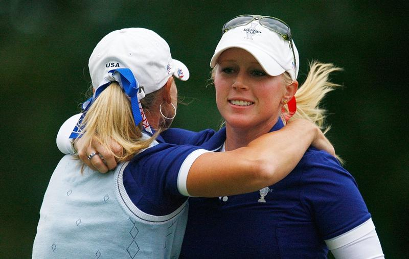 SUGAR GROVE, IL - AUGUST 22:  (L-R) Kristy McPherson hugs Morgan Pressel of the U.S. Team after Pressel holed a birdie putt on the 16th green during the saturday afternoon foursomes matches at the 2009 Solheim Cup at Rich Harvest Farms on August 22, 2009 in Sugar Grove, Illinois.  (Photo by Scott Halleran/Getty Images)