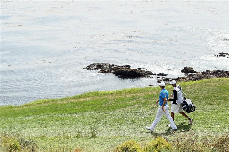 PEBBLE BEACH, CA - JUNE 20:  Dustin Johnson and his caddie Bobby Brown walk to the seventh green during the final round of the 110th U.S. Open at Pebble Beach Golf Links on June 20, 2010 in Pebble Beach, California.  (Photo by Jeff Gross/Getty Images)