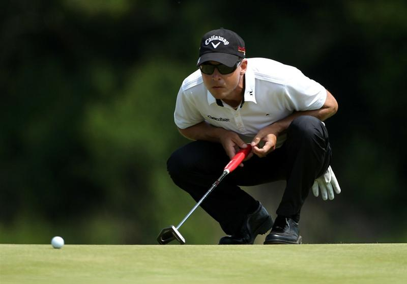 NEWPORT, WALES - JUNE 04:  Niclas Fasth of Sweden lines up a putt on the 17th hole during the second round of the Celtic Manor Wales Open on The Twenty Ten Course at The Celtic Manor Resort on June 4, 2010 in Newport, Wales.  (Photo by Andrew Redington/Getty Images)