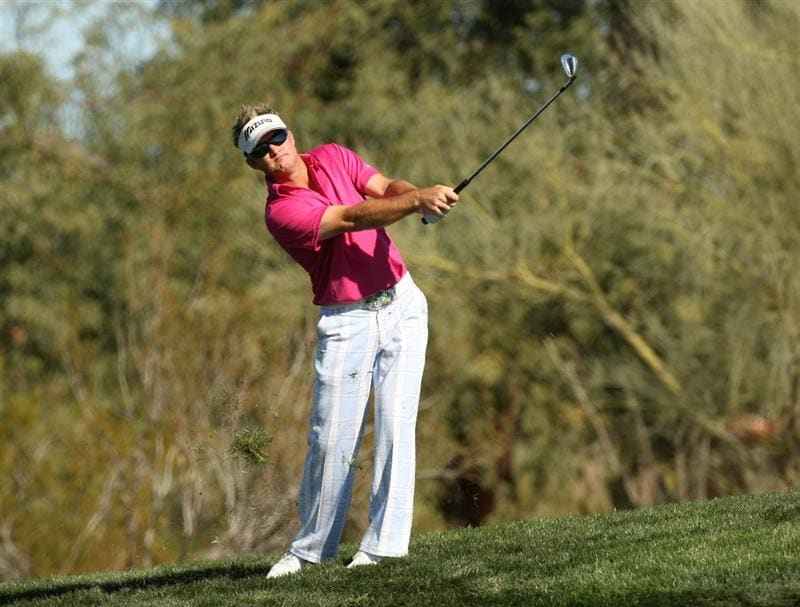 SCOTTSDALE, AZ - JANUARY 31:  Brian Gay hits his second shot on the second hole during the third round of the FBR Open on January 31, 2009 at TPC Scottsdale in Scottsdale, Arizona.  (Photo by Stephen Dunn/Getty Images)