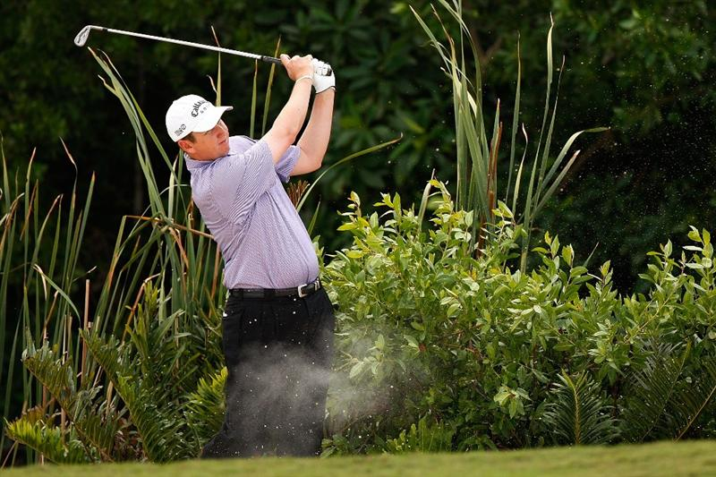 RIVIERA MAYA, MEXICO - MARCH 01:  J.J. Henry makes a shot from a fairway bunker on the 8th hole during the final round of the Mayakoba Golf Classic on March 1, 2009 at El Camaleon Golf Club in Riviera Maya, Mexico.  (Photo by Chris Graythen/Getty Images)