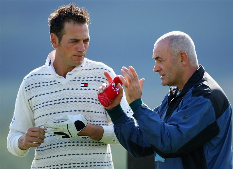 PERTH, UNITED KINGDOM - AUGUST 27:  Nick Dougherty of England talks with his fitness and mind coach, Ron 'The Rock' Cuthbert during the Pro-Am prior to the start of The Johnnie Walker Championship at Gleneagles on August 27, 2008 at the Gleneagles Hotel and Resort in Perthshire, Scotland.  (Photo by Andrew Redington/Getty Images)