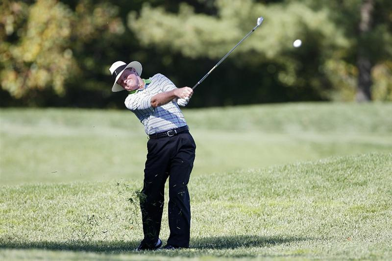 POTOMAC, MD - OCTOBER 08:  Tom Kite hits his second shot on the seventh hole from the rough during the second round of the Constellation Energy Senior Players Championship held at TPC Potomac at Avenel Farm on October 8, 2010 in Potomac, Maryland.  (Photo by Michael Cohen/Getty Images)