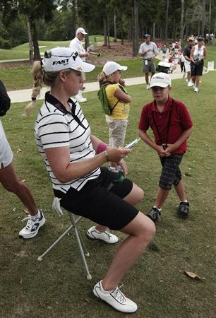 MOBILE, AL - MAY 15:  Golfer Brittany Lincicome (L) stis with fans outside the ropes on the tenth green as her playing partner putts out during third round play in the Bell Micro LPGA Classic at the Magnolia Grove Golf Course on May 15, 2010 in Mobile, Alabama.  (Photo by Dave Martin/Getty Images)
