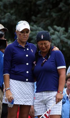 SUGAR GROVE, IL - AUGUST 22:  Christina Kim of the USa is comforted by her partner Natalie Gulbis on the 14th green after they had been beaten 5&4 by Becky Brewerton of Wales and Gwladys Nocera of France during the Saturday afternoon forsome matches at the 2009 Solheim Cup Matches, at the Rich Harvest Farms Golf Club on August 22, 2009 in Sugar Grove, Ilinois  (Photo by David Cannon/Getty Images)