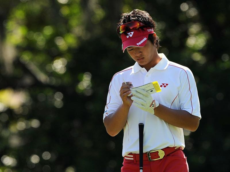 PALM HARBOR, FL - MARCH 22:  Ryo Ishikawa of Japan looks over the yardage on the ninth hole during the final round of the Transitions Championship at the Innisbrook Resort and Golf Club March 22, 2009 in Palm Harbor, Florida.  (Photo by Sam Greenwood/Getty Images)