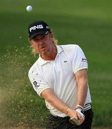 DUBAI, UNITED ARAB EMIRATES - FEBRUARY 10:  Miguel Angel Jimenez of Spain plays a bunker shot on the second hole during the first round of the Omega Dubai Desert Classic on the Majlis course at the Emirates Golf Club on February 10, 2011 in Dubai, United Arab Emirates.  (Photo by Andrew Redington/Getty Images)