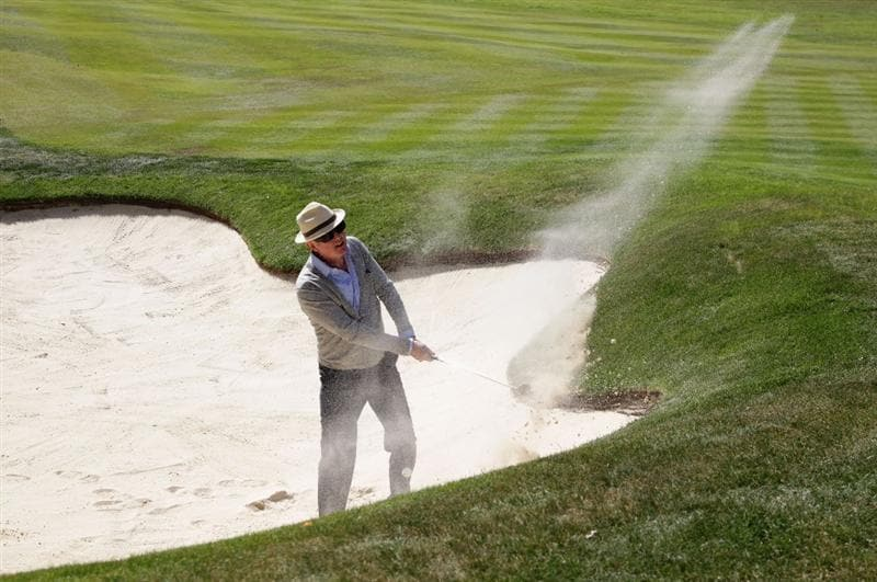 VIRGINIA WATER, ENGLAND - MAY 25: Chris Evans plays a bunker shot during the Pro-Am round prior to the BMW PGA Championship at Wentworth Club on May 25, 2011 in Virginia Water, England.  (Photo by David Cannon/Getty Images)