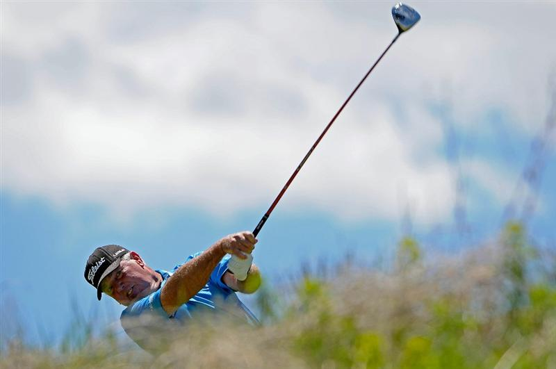 PARKER, CO. - MAY 30: Mark O'Meara tees off the 7th hole during the fourth and final round of the Senior PGA Championship at the Colorado Golf Club on May 30, 2010 in Parker, Colorado.  (Photo by Marc Feldman/Getty Images)