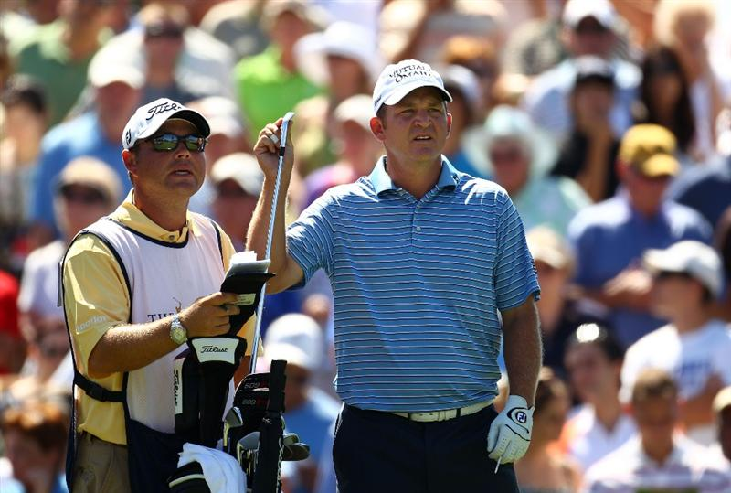 PONTE VEDRA BEACH, FL - MAY 09:  Jason Bohn pulls a cub on the third tee while alongside caddie Billy Spencer (L) during the final round of THE PLAYERS Championship held at THE PLAYERS Stadium course at TPC Sawgrass on May 9, 2010 in Ponte Vedra Beach, Florida.  (Photo by Richard Heathcote/Getty Images)