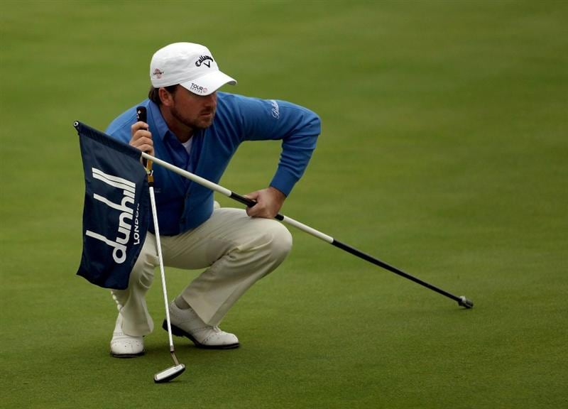 CARNOUSTIE, SCOTLAND - OCTOBER 09:  Graeme McDowell of Northern Ireland lines up his putt on the 12th green during the third round of The Alfred Dunhill Links Championship at the Carnoustie Golf Links on October 9, 2010 in Carnoustie, Scotland.  (Photo by Andrew Redington/Getty Images)
