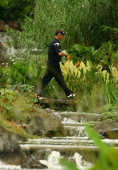 SINGAPORE - NOVEMBER 02:  Lee Westwood of England walks down the 16th hole during the 2nd round of the Barclays Singapore Open at Sentosa Golf Club on November 2, 2007 in Singapore.  (Photo by Ian Walton/Getty Images)