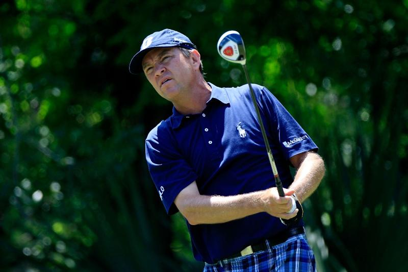 PONTE VEDRA BEACH, FL - MAY 15:  Davis Love III hits his tee shot on the fifth hole during the final round of THE PLAYERS Championship held at THE PLAYERS Stadium course at TPC Sawgrass on May 15, 2011 in Ponte Vedra Beach, Florida.  (Photo by Sam Greenwood/Getty Images)