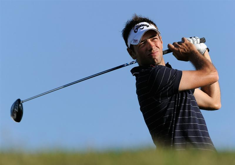 FARO, PORTUGAL - OCTOBER 14:  Nick Dougherty of England plays his tee shot on the 18th hole during the first round of the Portugal Masters at the Oceanico Victoria Golf Course on October 14, 2010 in Faro, Portugal.  (Photo by Stuart Franklin/Getty Images)