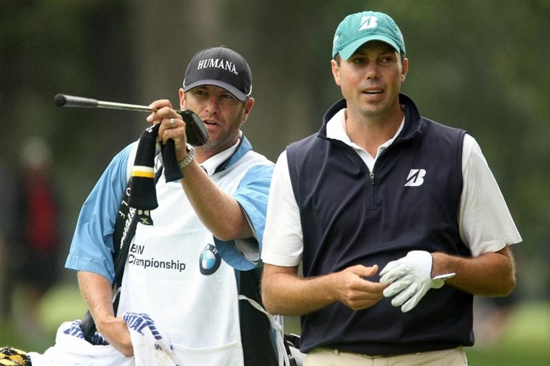 LEMONT, IL - SEPTEMBER 11:  Caddie Lance Bennett and Matt Kuchar talk over a shot on the ninth hole during the third round of the BMW Championship at Cog Hill Golf & Country Club on September 11, 2010 in Lemont, Illinois.  (Photo by Scott Halleran/Getty Images)