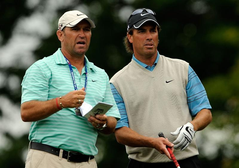 FARMINGDALE, NY - JUNE 16:  Caddie Dean Elliott and Stephen Ames of Canada talk during the second day of previews to the 109th U.S. Open on the Black Course at Bethpage State Park on June 16, 2009 in Farmingdale, New York.  (Photo by Sam Greenwood/Getty Images)