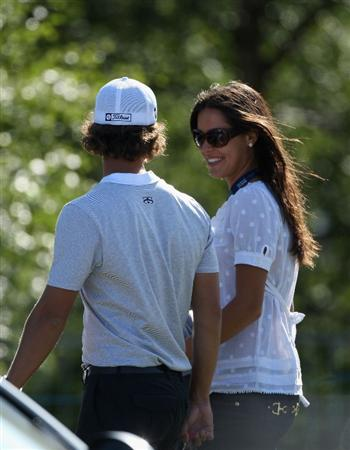 LUSS, UNITED KINGDOM - JULY 11:  Adam Scott of Australia walks with Ana Ivanovic during the Third Round of The Barclays Scottish Open at Loch Lomond Golf Club on July 11, 2009 in Luss, Scotland. (Photo by Andrew Redington/Getty Images)