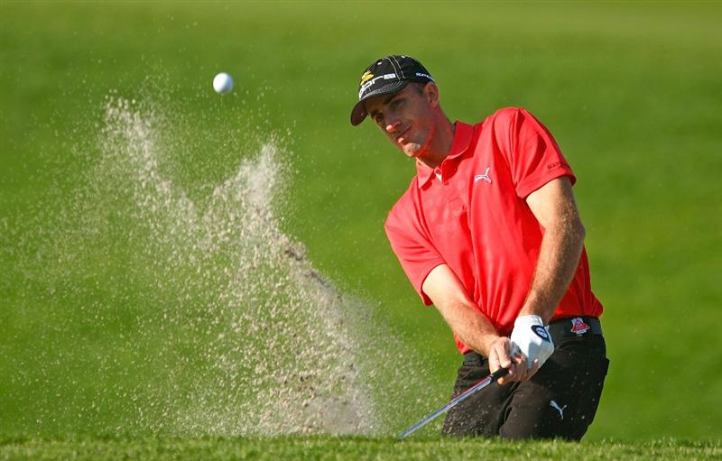 SHANGHAI, CHINA - NOVEMBER 04:  Geoff Ogilvy of Australia plays a bunker shot during the pro-am prior to the start of the WGC-HSBC Champions at Sheshan International Golf Club on November 4, 2009 in Shanghai, China.  (Photo by Scott Halleran/Getty Images)