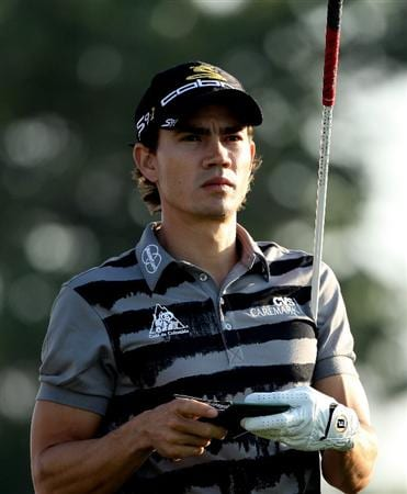 ABU DHABI, UNITED ARAB EMIRATES - JANUARY 22:  Camilo Villegas of Colombia waits to hit his tee-shot on the 11th hole during the second round of The Abu Dhabi Golf Championship at Abu Dhabi Golf Club on January 22, 2010 in Abu Dhabi, United Arab Emirates.  (Photo by Andrew Redington/Getty Images)