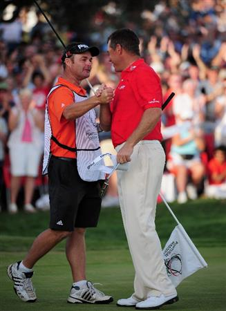 VILAMOURA, PORTUGAL - OCTOBER 18:  Lee Westwood of England celebrates winning with his caddie Billy Foster on the 18th hole during the final round of the Portugal Masters at the Oceanico Victoria Golf Course on October 18, 2009 in Vilamoura, Portugal.  (Photo by Stuart Franklin/Getty Images)