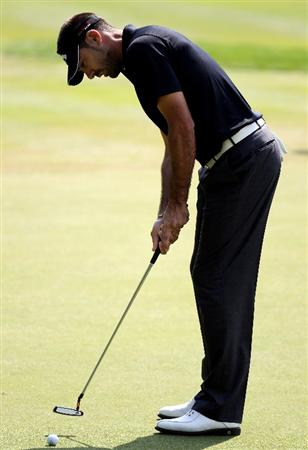 VIRGINIA WATER, ENGLAND - MAY 18:   Alvaro Quiros of Spain  putts during a practice round at Wentworth prior to the BMW PGA Championship on May 18, 2010 in Virginia Water, England.  (Photo by Ross Kinnaird/Getty Images)