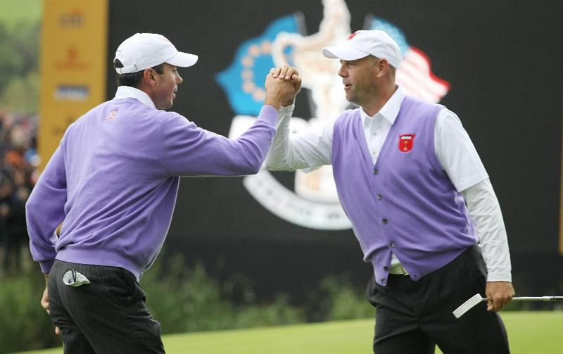 NEWPORT, WALES - OCTOBER 02:  Stewart Cink of the USA celebrates with Matt Kuchar (L) during the rescheduled Afternoon Foursome Matches during the 2010 Ryder Cup at the Celtic Manor Resort on October 2, 2010 in Newport, Wales. (Photo by Andy Lyons/Getty Images)