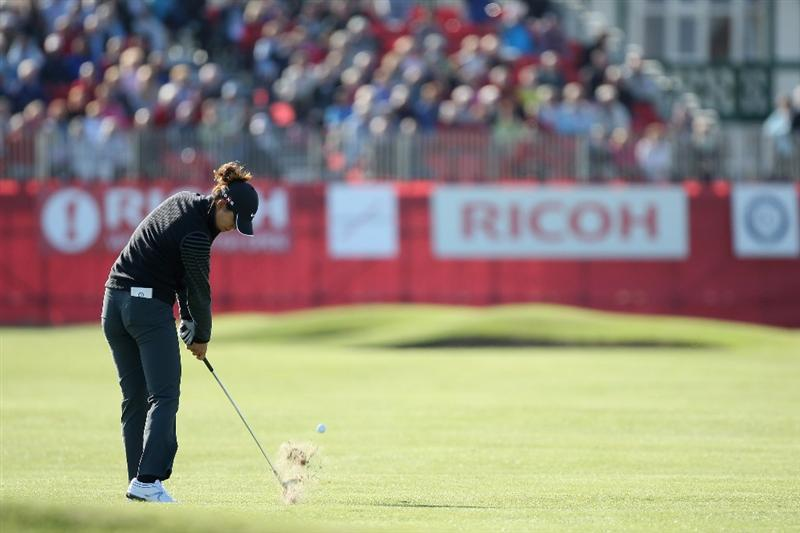LYTHAM ST ANNES, ENGLAND - JULY 30:  Michelle Wie of USA hits her approach to the 18th green during the first round of the 2009 Ricoh Women's British Open Championship held at Royal Lytham St Annes Golf Club, on July 30, 2009 in  Lytham St Annes, England.  (Photo by David Cannon/Getty Images)