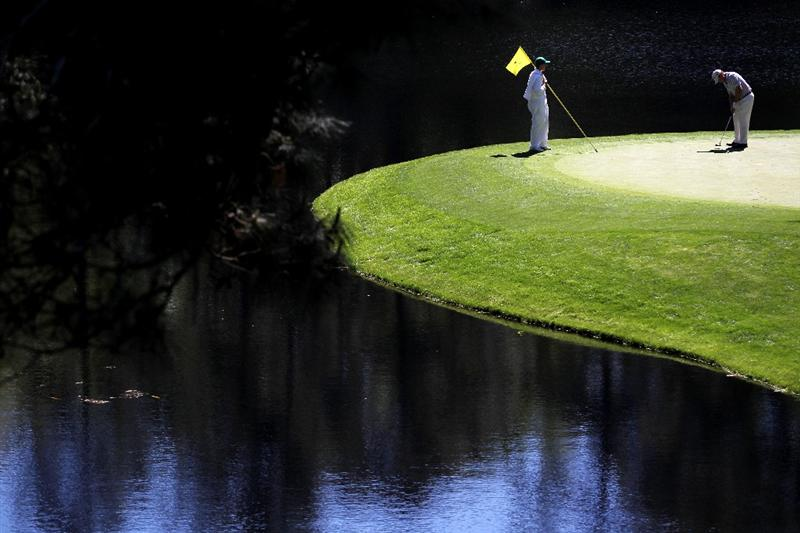 AUGUSTA, GA - APRIL 06:  Tom Watson putts while his caddie looks on during the Par 3 Contest prior to the 2011 Masters Tournament at Augusta National Golf Club on April 6, 2011 in Augusta, Georgia.  (Photo by Jamie Squire/Getty Images)