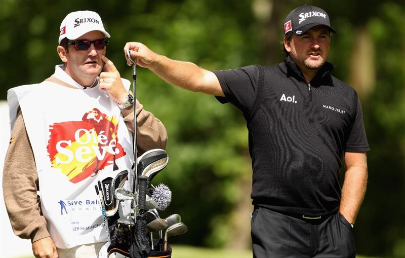 VIRGINIA WATER, ENGLAND - MAY 23:  Graeme McDowell of Northern Ireland walks with his caddie Ken Comboy during the 'Ole Seve' Pro-Am in aid of the Seve Ballesteros Foundation at Wentworth Club on May 23, 2011 in Virginia Water, England.  (Photo by Andrew Redington/Getty Images)