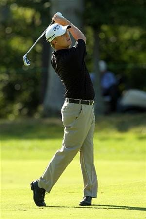 NORTON, MA - SEPTEMBER 04:  David Toms hits a shot on the 12th hole during the second round of the Deutsche Bank Championship at TPC Boston on September 4, 2010 in Norton, Massachusetts.  (Photo by Mike Ehrmann/Getty Images)