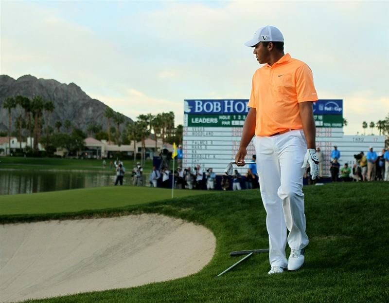 LA QUINTA, CA - JANUARY 23:  Jhonattan Vegas of Venezuela surveys the green before making his pitch shot on the first playoff hole during the final round of the Bob Hope Classic on the Palmer Private Course at PGA West on January 23, 2011 in La Quinta, California.  Vegas went on to win on the second playoff hole.  (Photo by Stephen Dunn/Getty Images)