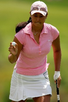 MORELIA, MEXICO - APRIL 28:  Hana Kim of the United States acknowldges the gallery after holing out on the third green during the third round of the Corona Championship April 28, 2007 at Tres Marias Club de Golf in Morelia, Michoacan, Mexico.  (Photo by Matthew Stockman/Getty Images)