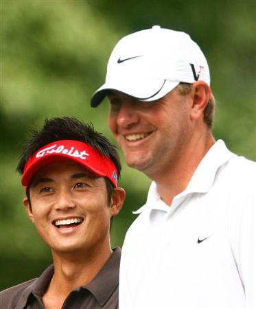 BETHESDA, MD - JULY 05:  Ryuji Imada of Japan and Lucas Glover wait on the first tee during the final round of the AT&T National at the Congressional Country Club on July 5, 2009 in Bethesda, Maryland.  (Photo by Scott Halleran/Getty Images)
