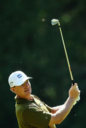 VIRGINIA WATER, ENGLAND - MAY 22:  Ernie Els of South Africa plays an iron shot during the third round of the BMW PGA Championship on the West Course at Wentworth on May 22, 2010 in Virginia Water, England.  (Photo by Warren Little/Getty Images)