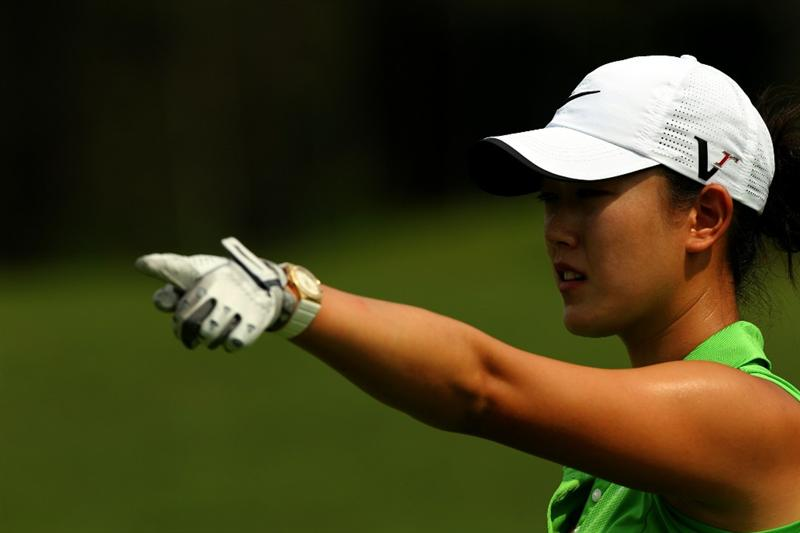 KUALA LUMPUR, MALAYSIA : Michelle Wie of USA points to a direction on the 5th hole during the Sime Darby Pro-Am at the KLGCC Golf Course on October 21, 2010 in Kuala Lumpur, Malaysia (Photo by Stanley Chou/Getty Images)