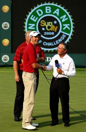 SUN CITY, SOUTH AFRICA - DECEMBER 07:  Henrik Stenson of Sweden is congratulated by Gary Player of South Africa after the final round of the Nedbank Golf Challenge at the Gary Player Country Club on December 7, 2008 in Sun City, South Africa.  (Photo by Richard Heathcote/Getty Images)