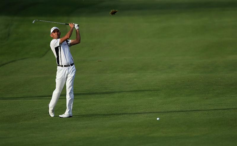 DOHA, QATAR - FEBRUARY 05:  Markus Brier of Austria hits his third shot on the 18th hole during the third round of the Commercialbank Qatar Masters held at Doha Golf Club on February 5, 2011 in Doha, Qatar.  (Photo by Andrew Redington/Getty Images)
