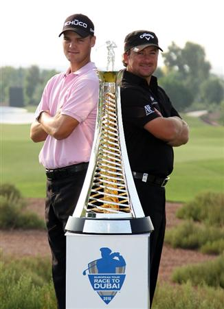 DUBAI, UNITED ARAB EMIRATES - NOVEMBER 23:  Martin Kaymer of Germany and Graeme McDowell of Northern Ireland pose with the Race to Dubai trophy during the Pro Am prior to the start of the Dubai World Championship on the Earth Course, Jumeirah Golf Estates on November 23, 2010 in Dubai, United Arab Emirates.  (Photo by Ross Kinnaird/Getty Images)