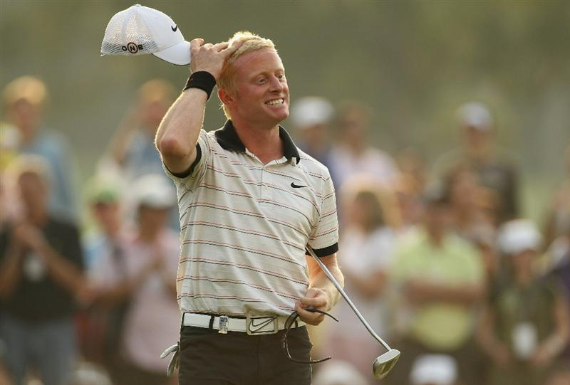 HONG KONG - NOVEMBER 21:  Simon Dyson of England celebrates his second place finish on the 18th hole during day four of the UBS Hong Kong Open at The Hong Kong Golf Club on November 21, 2010 in Hong Kong.  (Photo by Ian Walton/Getty Images)