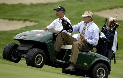 Tom Lehman is driven to the 18th tee for the first playoff hole during the final round of The International on Sunday, August 13, 2006 at Castle Pines Golf Club in Castle Rock, Colorado. Photo by Marc Feldman/WireImage.com
