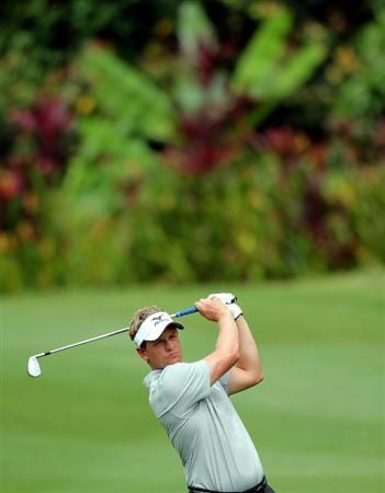 KUALA LUMPUR, MALAYSIA - OCTOBER 28: Luke Donald of England watches his 2nd shot on the 1st tee during day one of the CIMB Asia Pacific Classic at The MINES Resort & Golf Club on October 28, 2010 in Kuala Lumpur, Malaysia. (Photo by Stanley Chou/Getty Images)