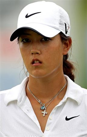 SINGAPORE - FEBRUARY 27:  Michelle Wie of the USA on the 18th hole during the third round of the HSBC Women's Champions at the Tanah Merah Country Club on February 27, 2010 in Singapore.  (Photo by Andrew Redington/Getty Images)
