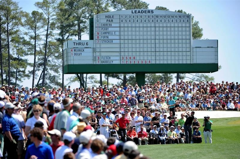 AUGUSTA, GA - APRIL 12:  Phil Mickelson hits his tee shot on the third hole as Tiger Woods looks on during the final round of the 2009 Masters Tournament at Augusta National Golf Club on April 12, 2009 in Augusta, Georgia.  (Photo by Harry How/Getty Images)
