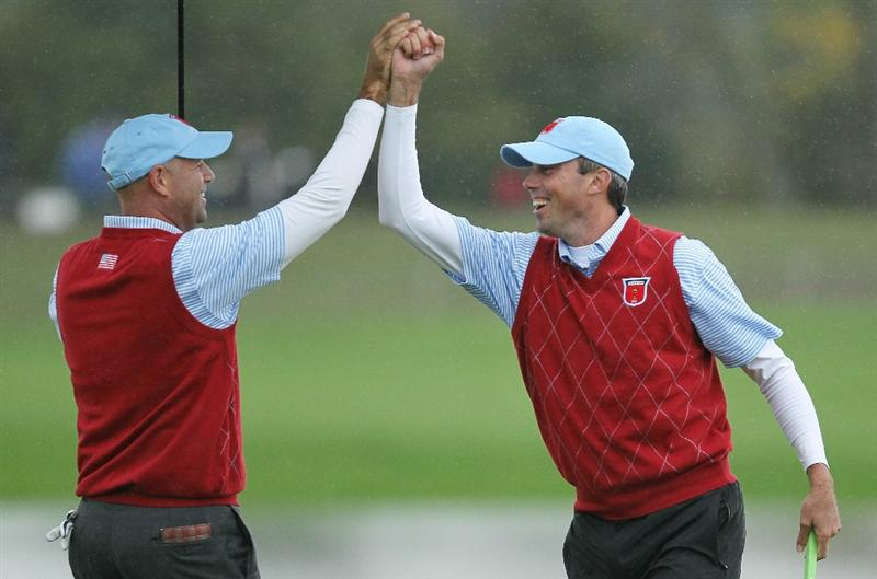 NEWPORT, WALES - OCTOBER 03:  Stewart Cink (L) of the USA celebrates with team mate Matt Kuchar on the 13th green during the  Fourball & Foursome Matches during the 2010 Ryder Cup at the Celtic Manor Resort on October 3, 2010 in Newport, Wales.  (Photo by Andy Lyons/Getty Images)